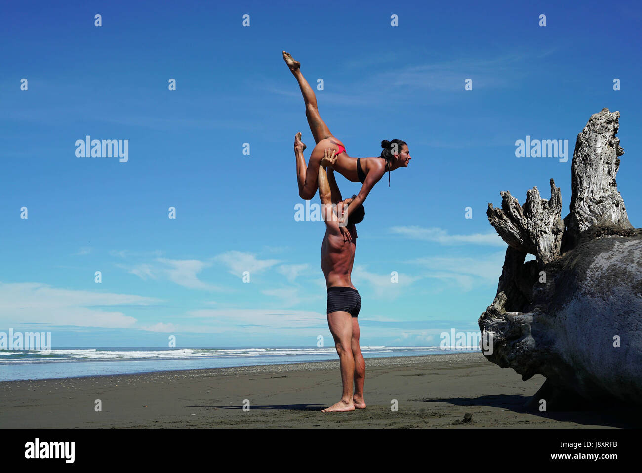 STUNNING photographs and video have revealed one couple's incredible bond as they combine their passions for yoga - Stock Image