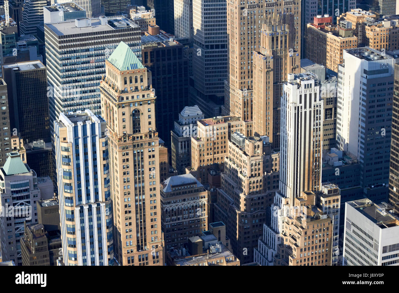 view over mixed era skyscrapers in midtown manhattan New York City USA including 425 fifth ave, mercantile building, - Stock Image