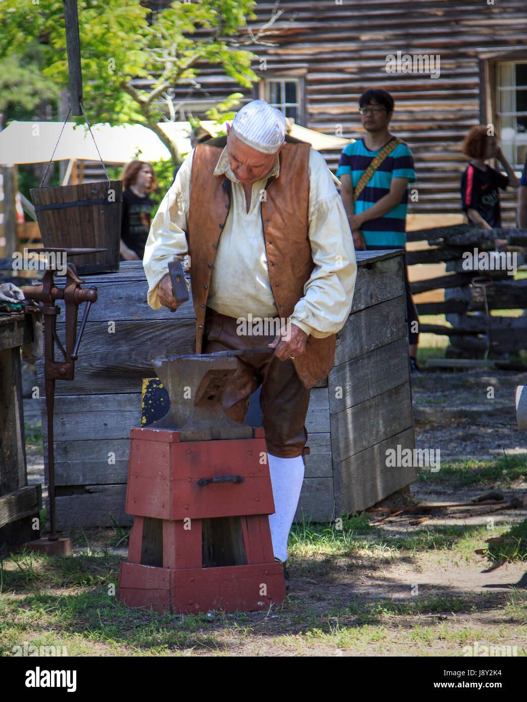 Black Smith working during US civil war reenactment Bennett Place Durham North Carolina - Stock Image