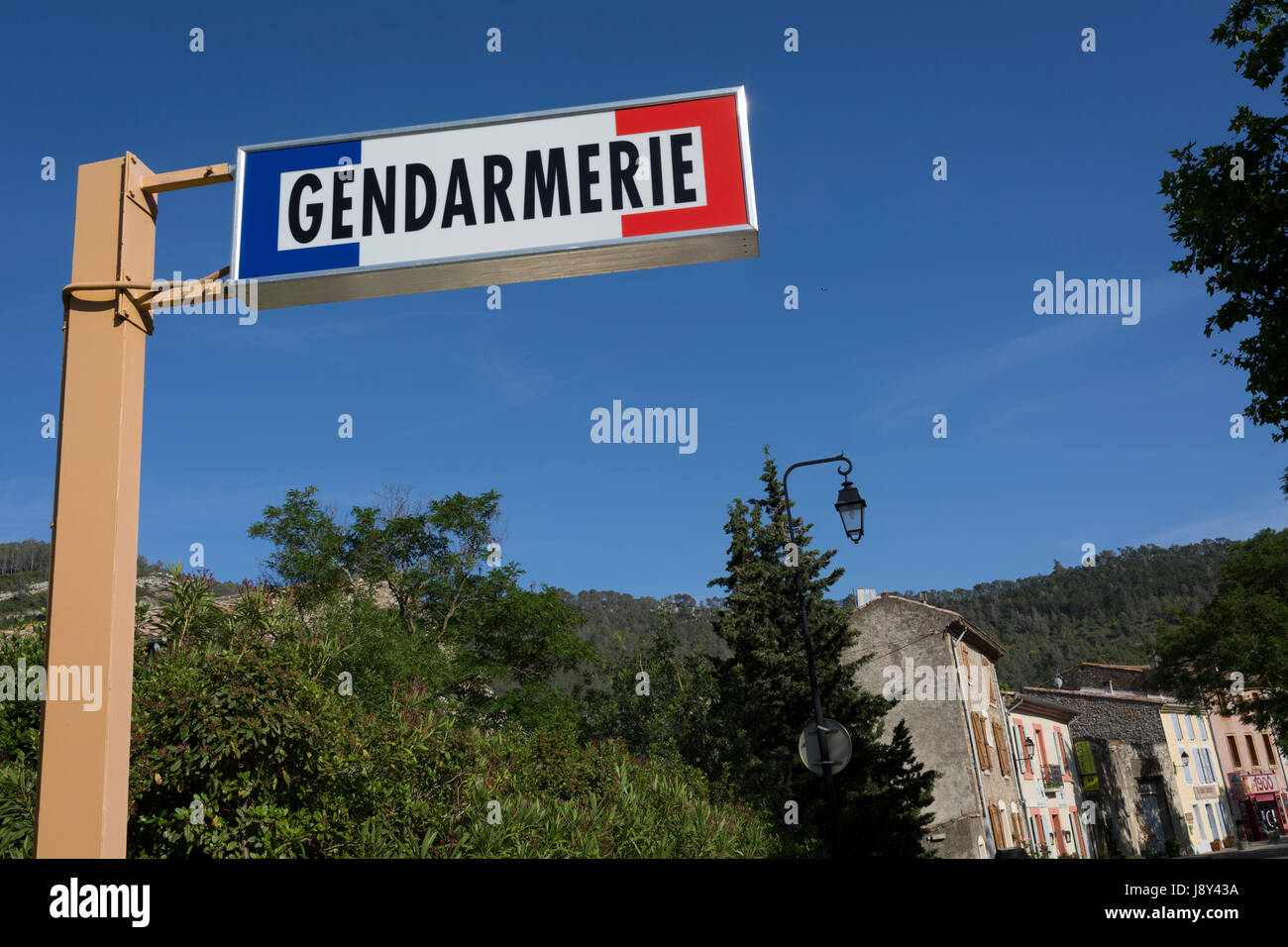 The signpost for the local Gendarmerie in blue skies, on 23rd May, 2017, in Lagrasse, Languedoc-Rousillon, south - Stock Image