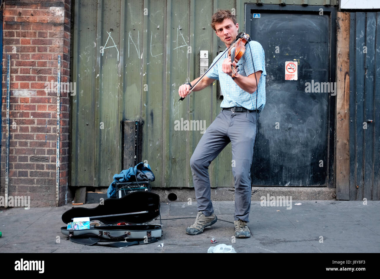 London Street Musician or Busker, playing Violin  on the streets of Camden Town, London. - Stock Image
