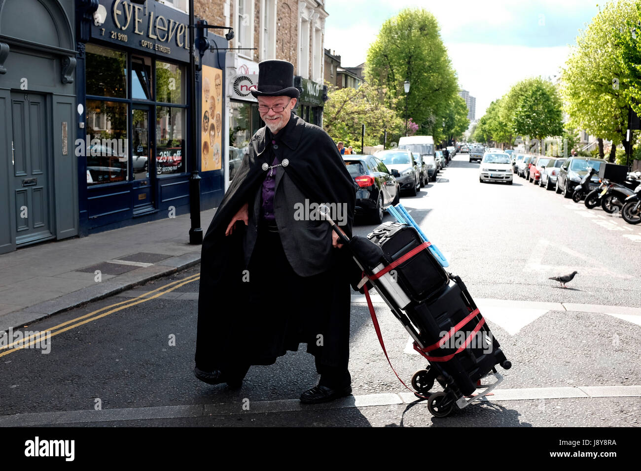 Traveling magician, Notting Hill, London, England, UK. Stock Photo