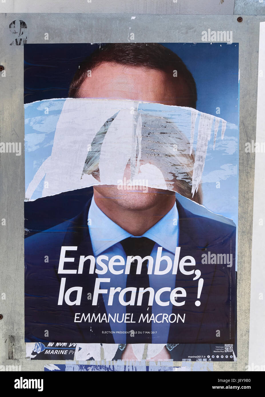 portrait of Emmanuel Macron vandalized and disfigured by vandals during french presidential election in France - Stock Image