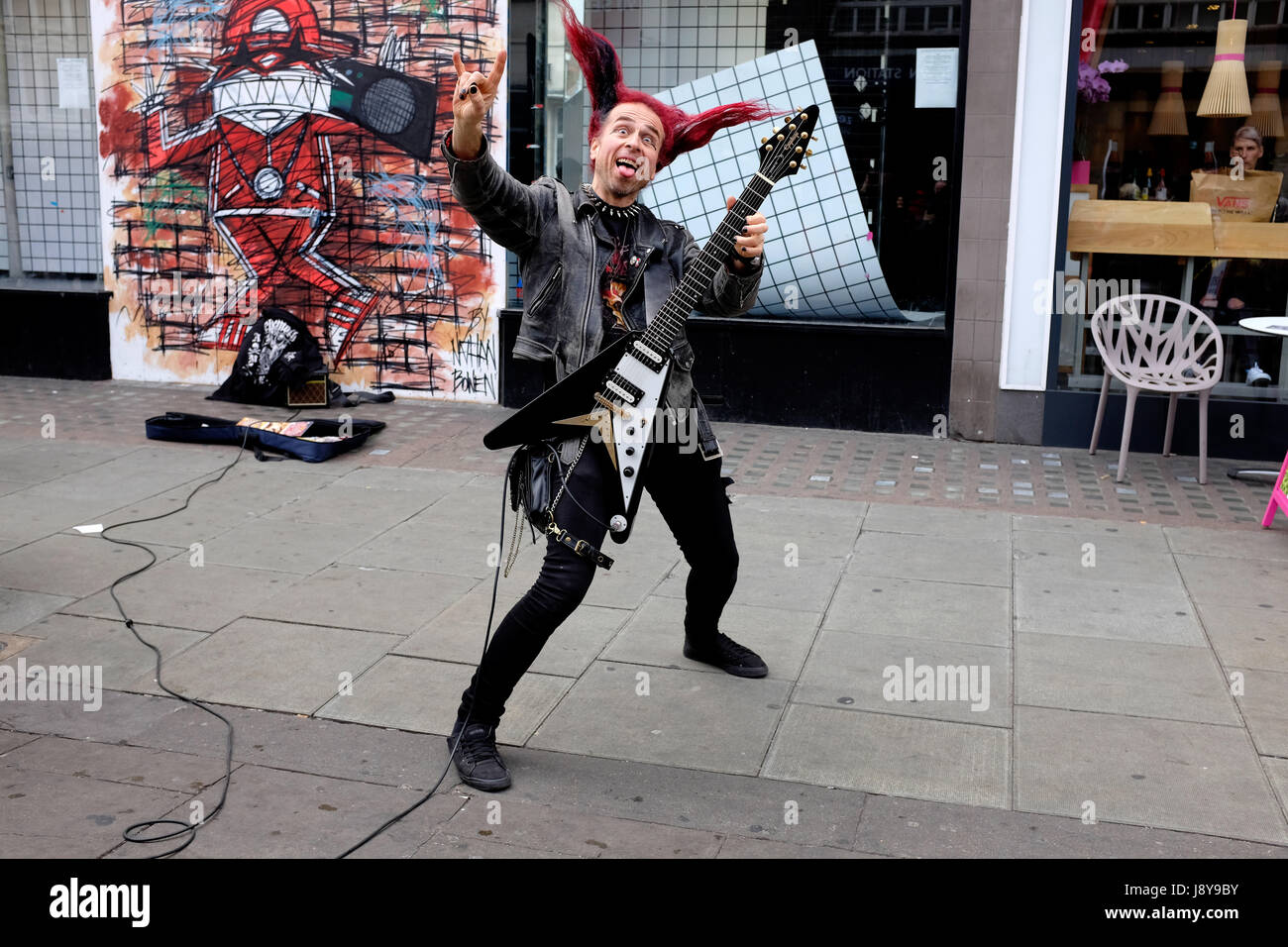 London Street Musician or Busker, playing guitar on the streets of Camden Town, London. - Stock Image