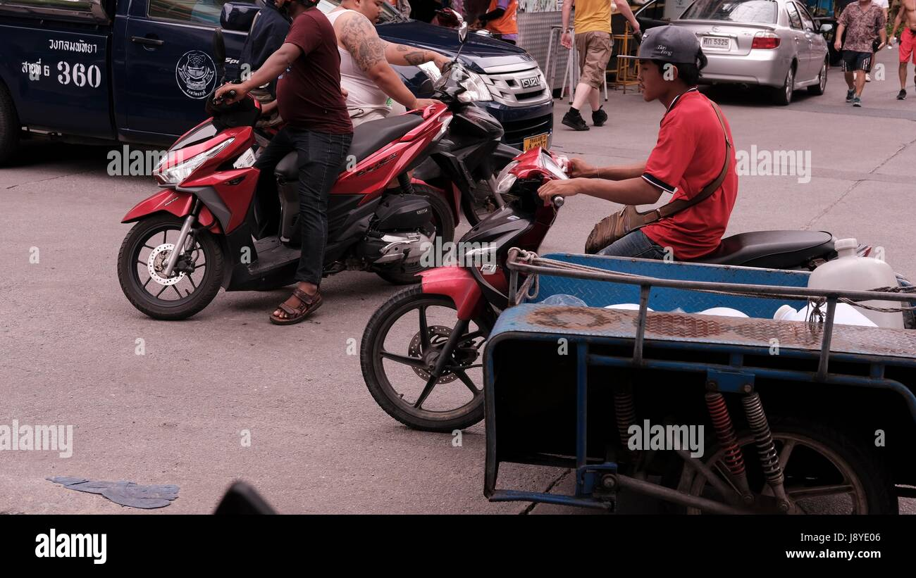 Sidecar Motor Bikes in Traffic at Soi Buakhao and Soi Diana Pattaya Thailand's Most Dangerous Intersection on a Stock Photo