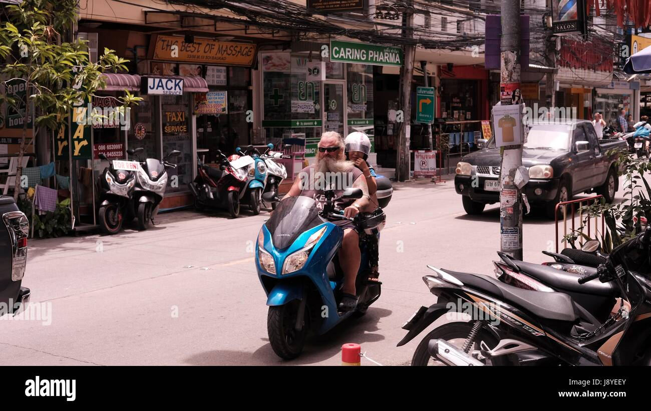 Motor Bikes in Traffic at Soi Buakhao and Soi Diana Pattaya Thailand's Most Dangerous Intersection on a gloomy overcast Stock Photo