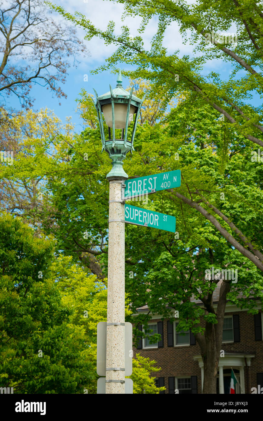 Chicago Illinois Oak Park Forest Avenue Superior Street ornate street lamp street scene street sign road sign signs - Stock Image