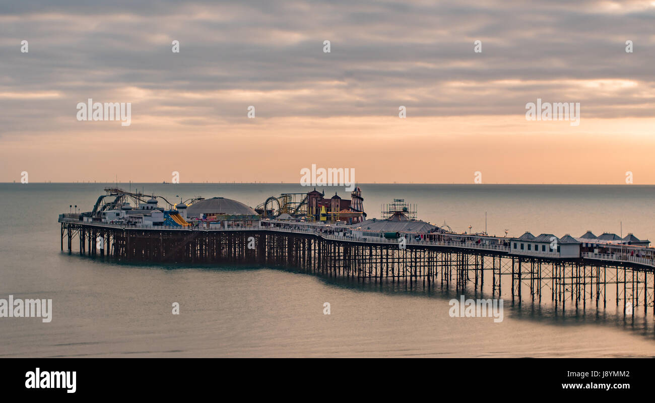 View of a sunset on the pier in Brighton and Hove, Southern England - Stock Image