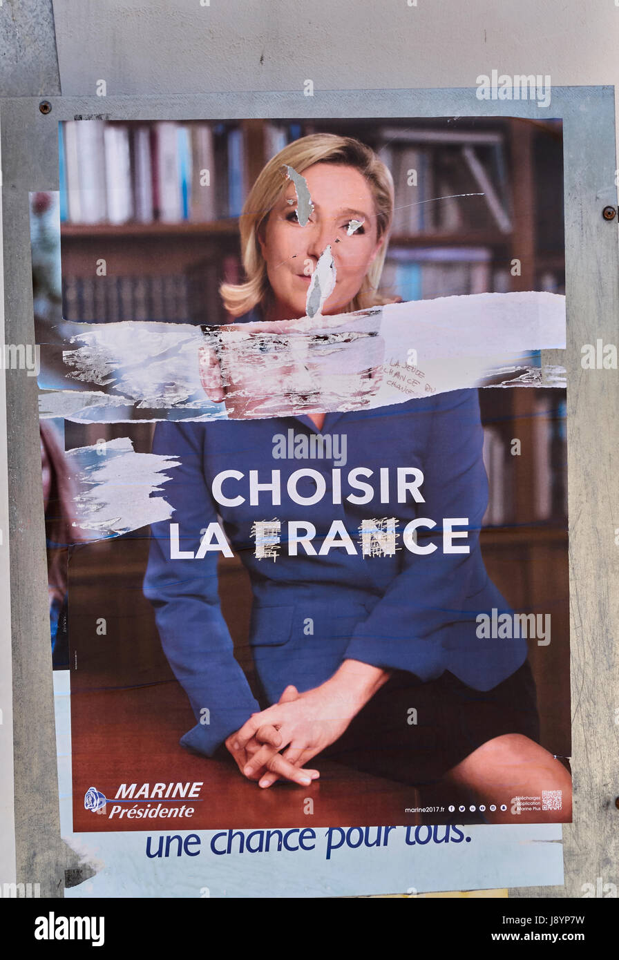 portrait of Marine Le Pen vandalized and disfigured by vandals during french presidential election in France - Stock Image