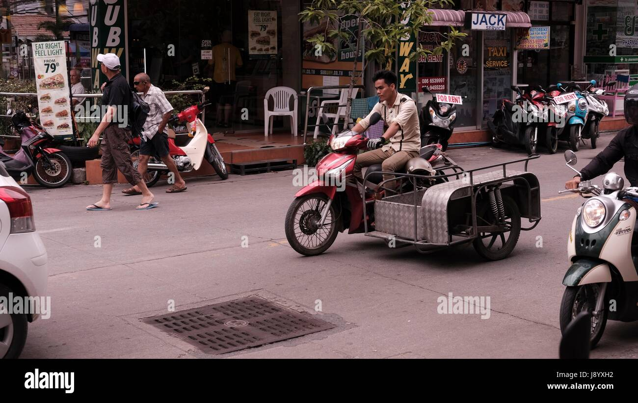 Tricycle Motor Bike with sidecar in Traffic at Soi Buakhao and Soi Diana Pattaya Thailand's Most Dangerous Intersection Stock Photo