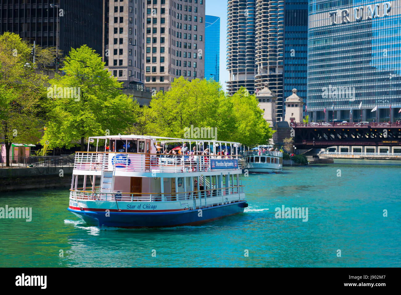 View Chicago River Illinois Trump Tower skyscrapers blue sky Star of Chicago sightseers tourists tourism architectural - Stock Image