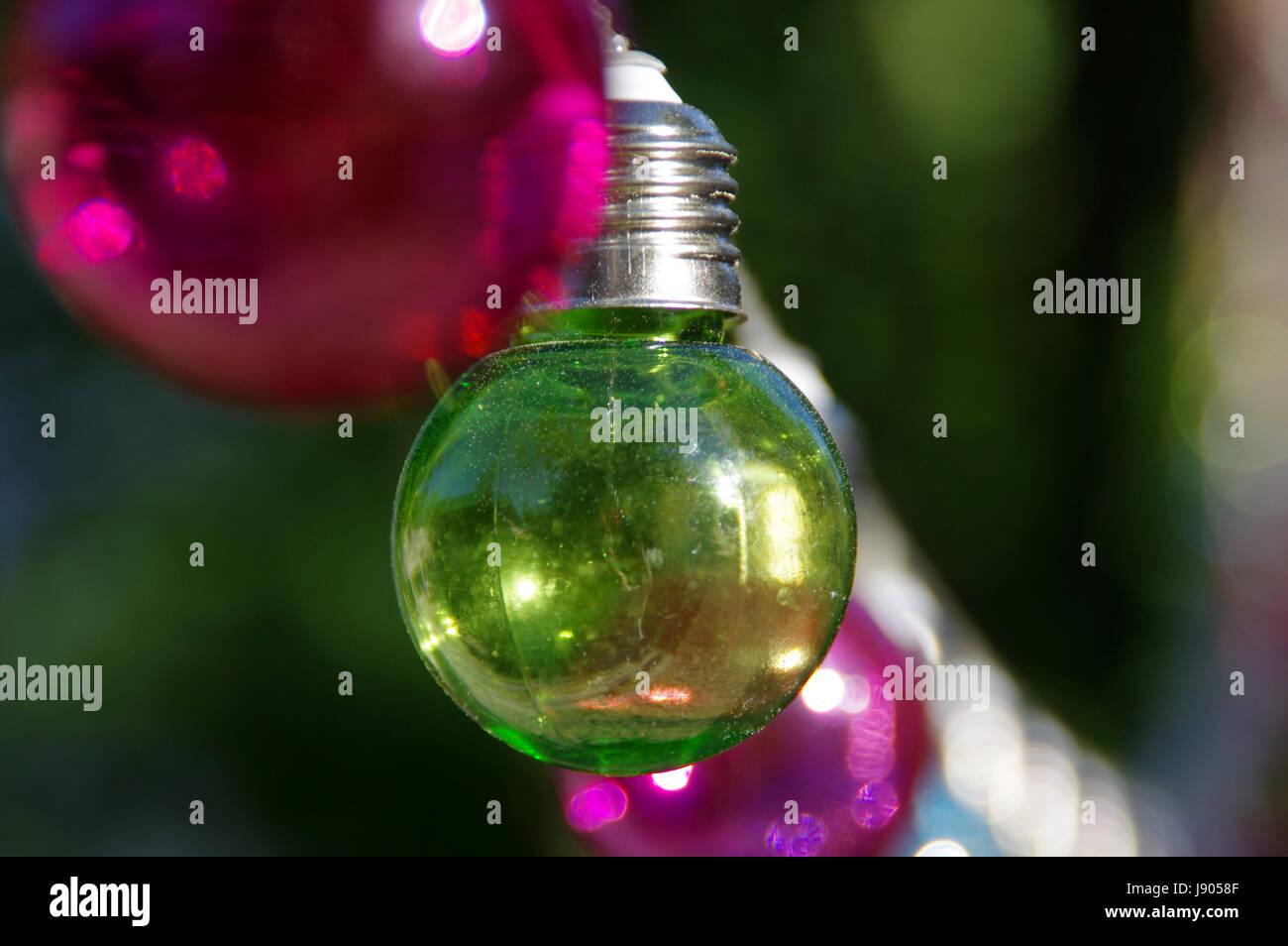 Green vitreous bulb on dark background - Stock Image