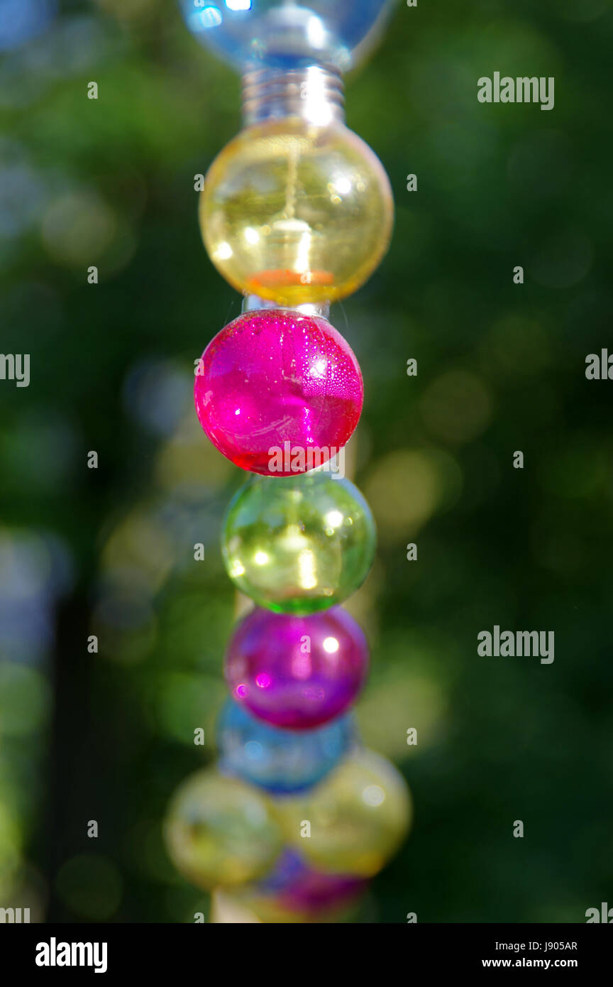 Colorful vitreous bulbs. Lamps on wire. - Stock Image