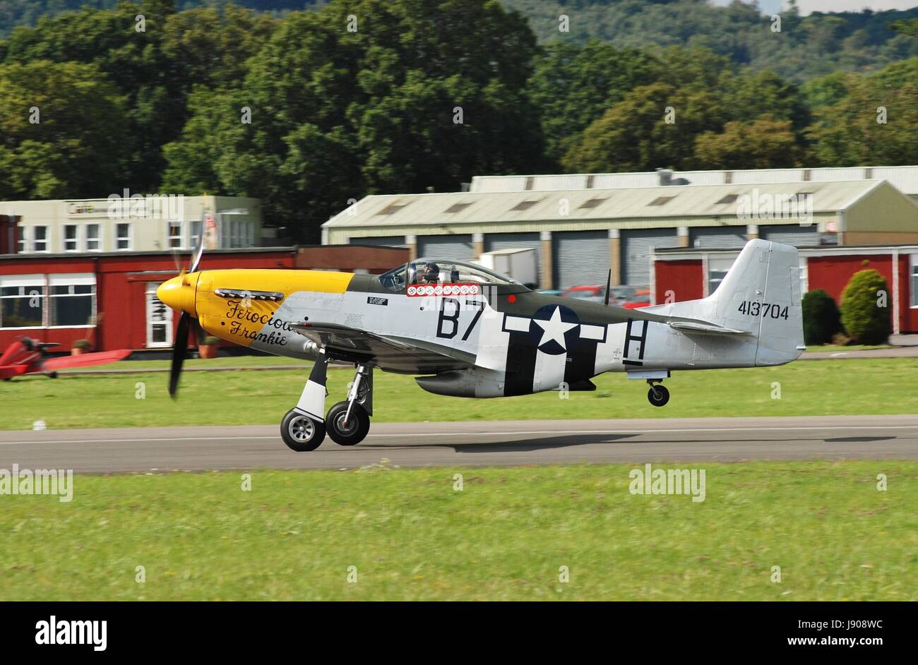 P-51D Mustang fighter Ferocious Frankie taking off during the Dunsfold airshow in Surrey, England on August 23, Stock Photo