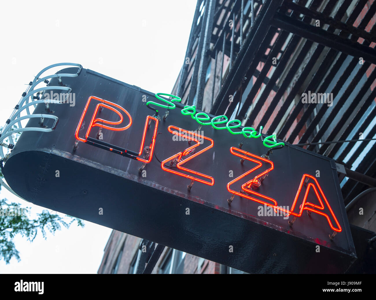 Sign above a pizzeria in the Chelsea area of New York City - Stock Image