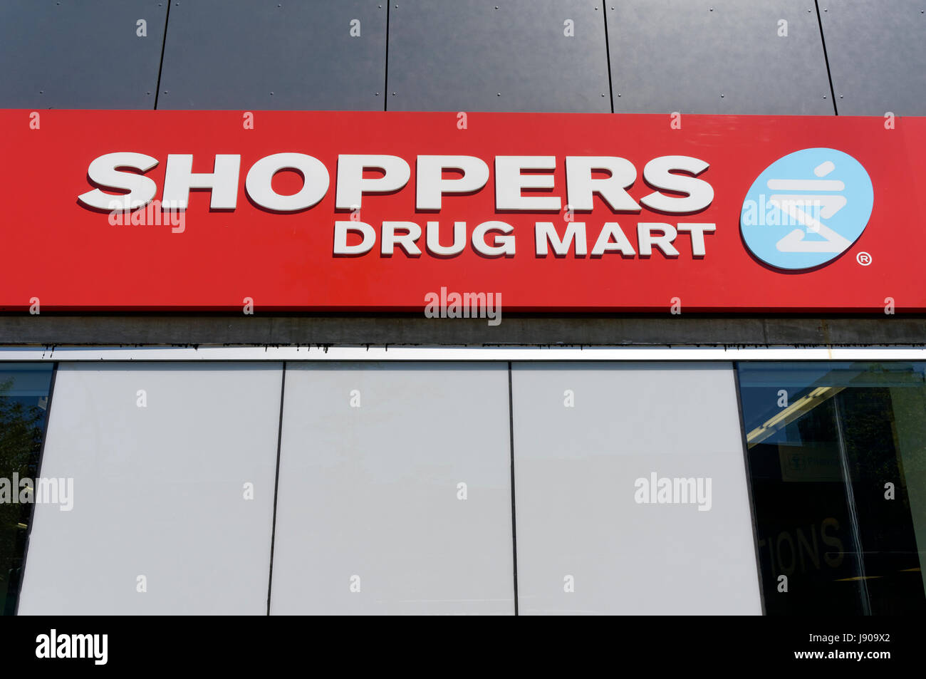 Close-up of a Shoppers Drug Mart pharmacy sign in Vancouver