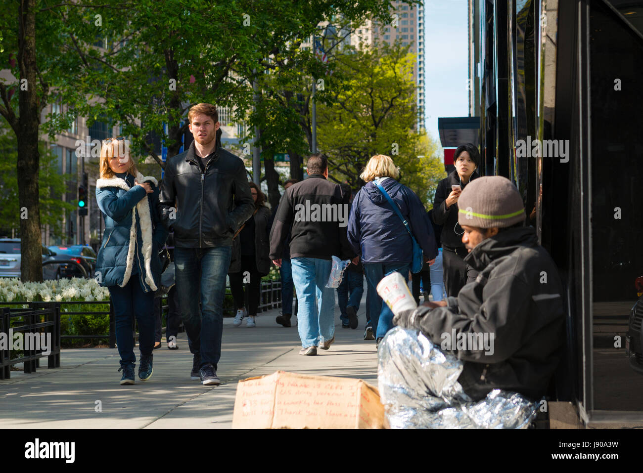 Chicago Illinois Near North Side N Michigan Avenue Magnificent Mile pavement pavement scene beggar homeless US Navy - Stock Image