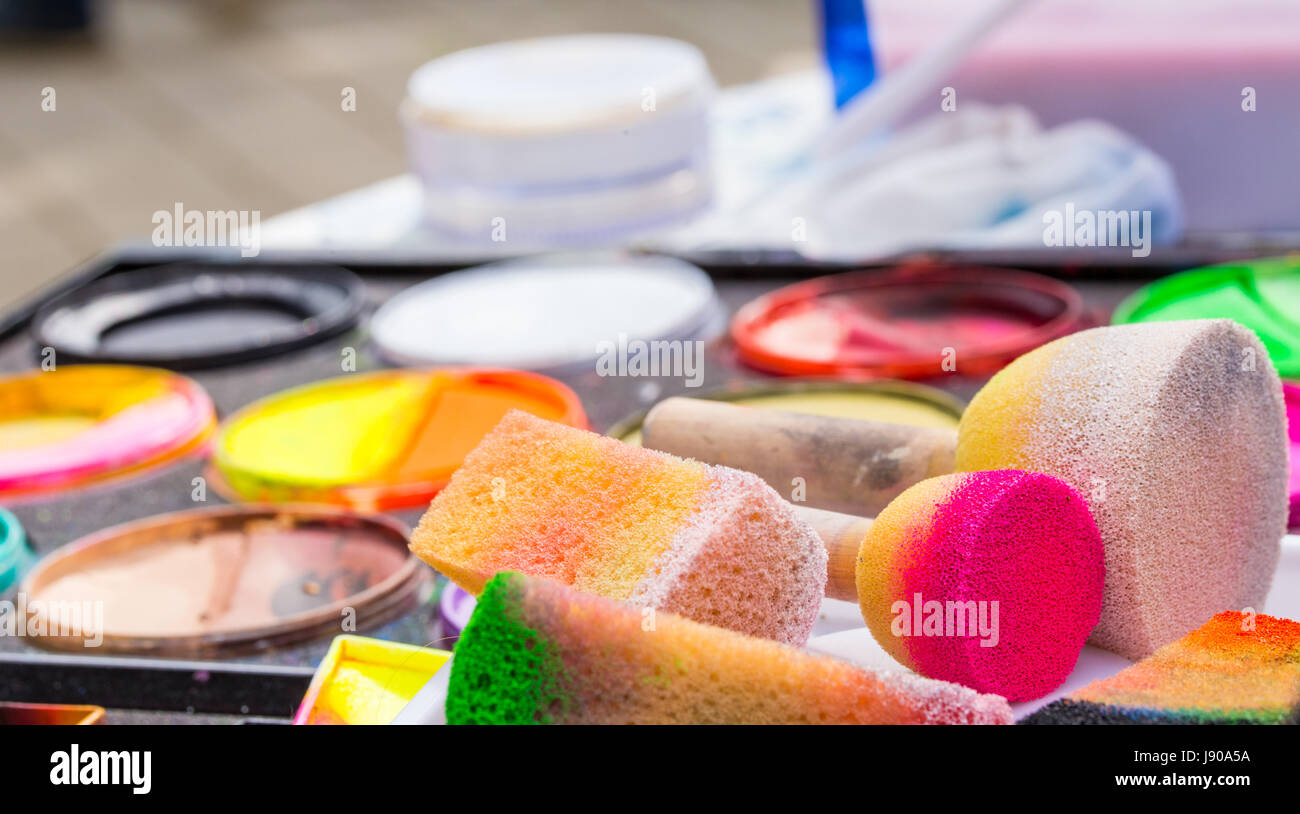 Color cosmetics, brushes and sponges for face painting. Children party - Stock Image