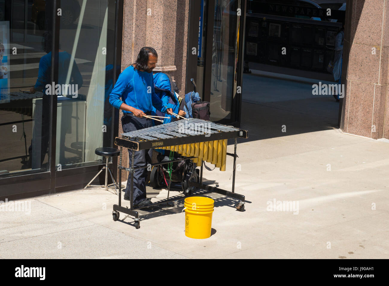 Chicago Illinois South Michigan Ave bearded busker street entertainer musician playing xylophone on pavement sidewalk - Stock Image