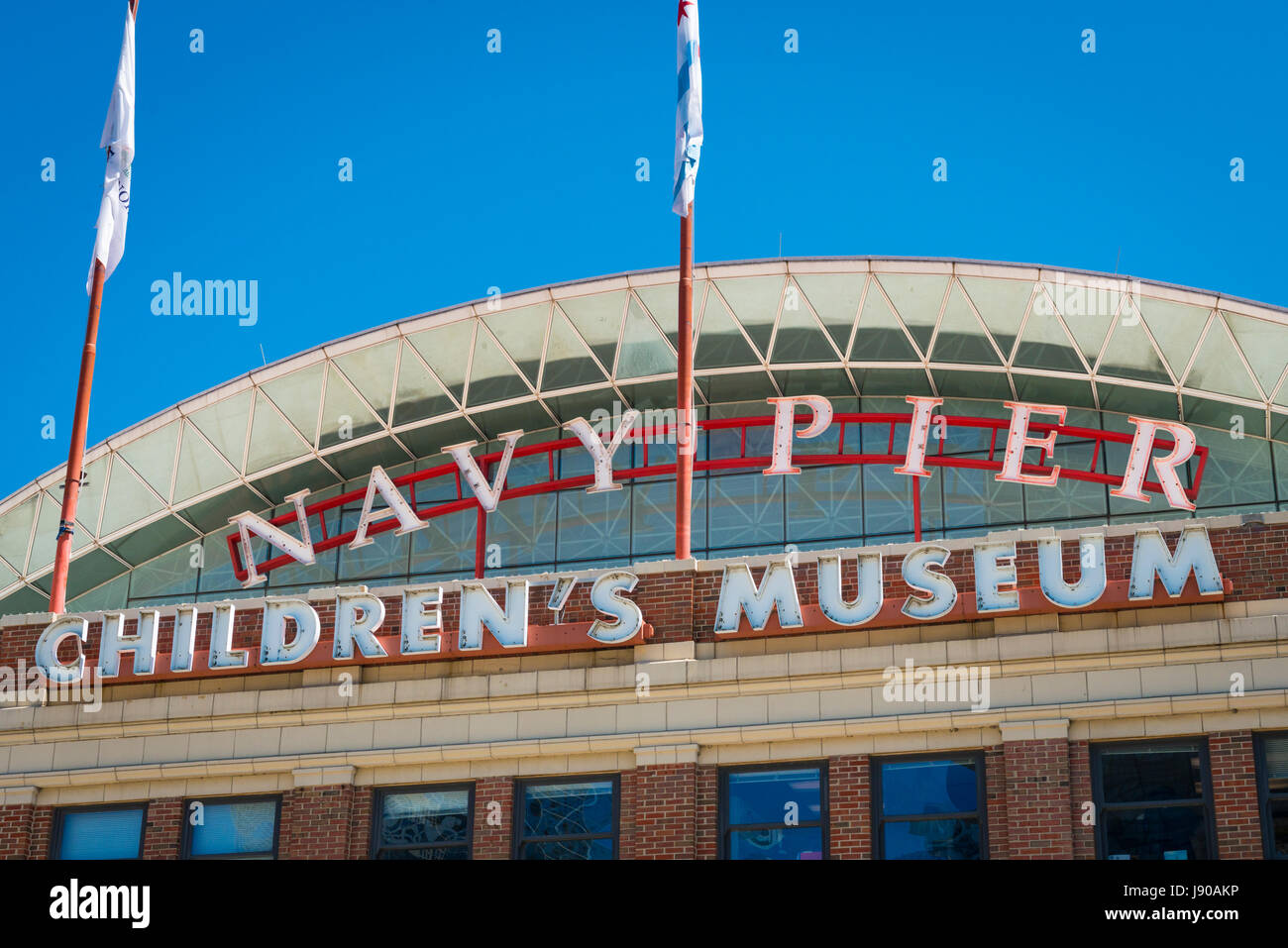 Chicago Illinois Near North Side E Grand Avenue Navy Pier Childrens Museum flags flag recreational cultural centre - Stock Image
