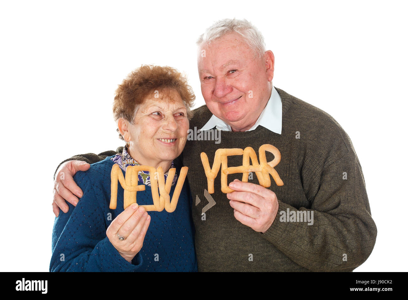 Picture of an elderly couple celebrating new year - isolated background - Stock Image