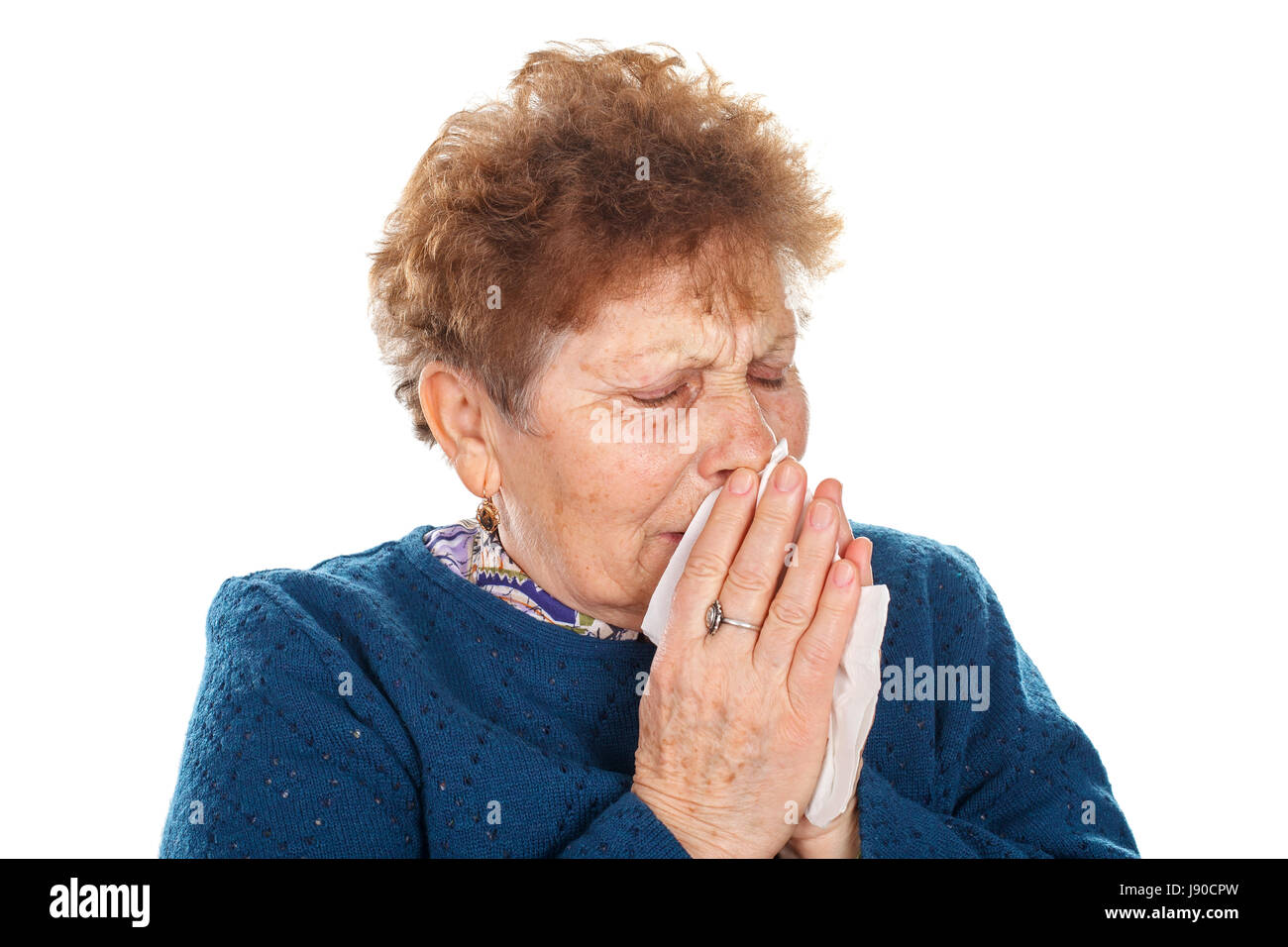 Picture of an elderly woman having a flu - isolated background - Stock Image
