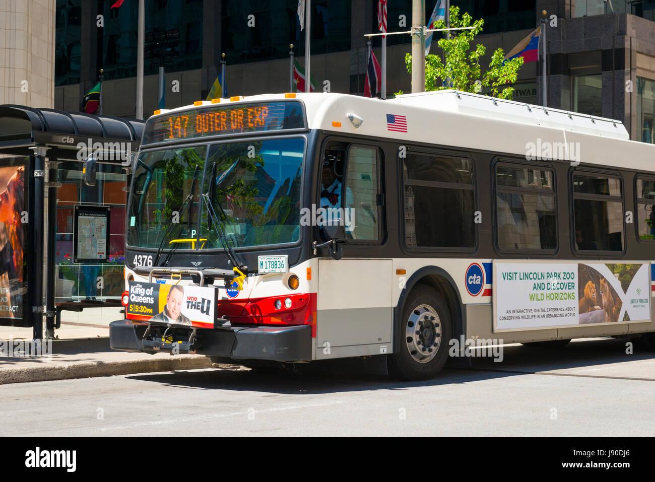 Chicago Illinois Near North Side Michigan Avenue CTA 147 bus public transport bus stop bike rack on front street - Stock Image