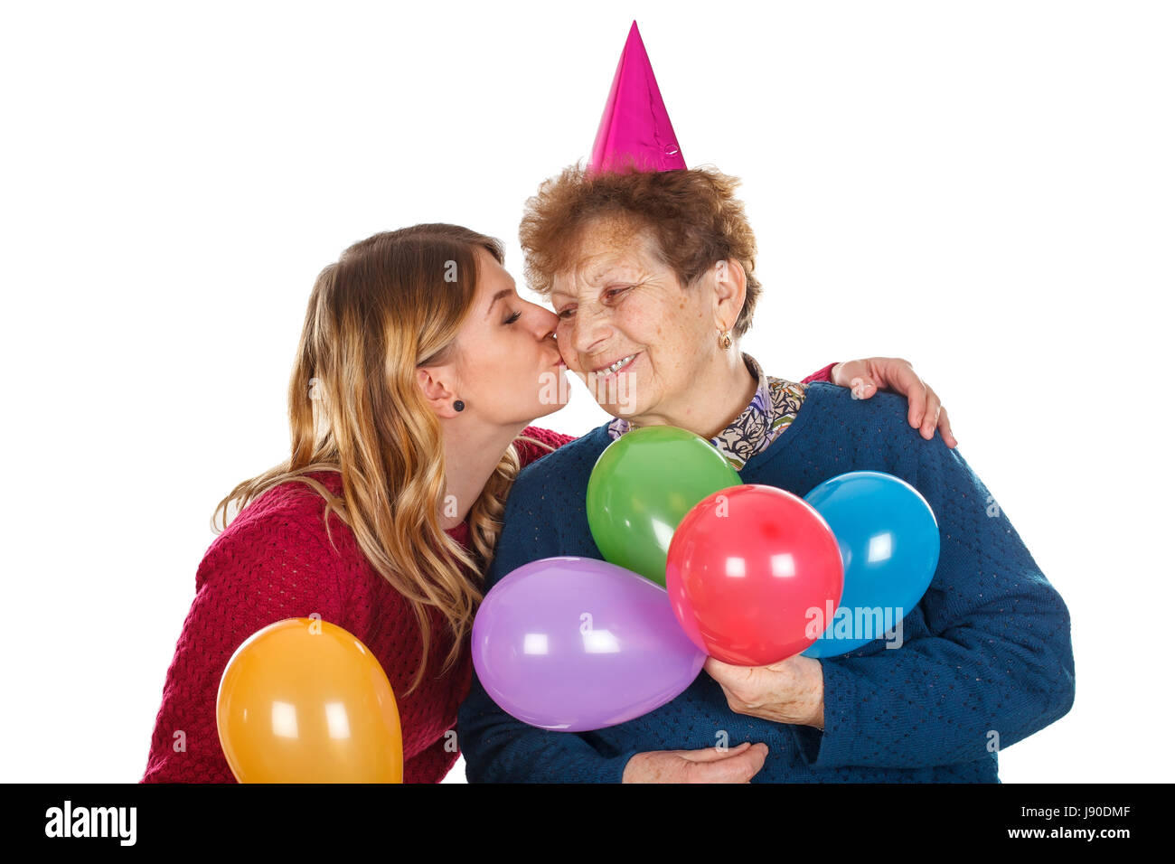 Picture of a senior lady celebrating birthday with her granddaughter - Stock Image
