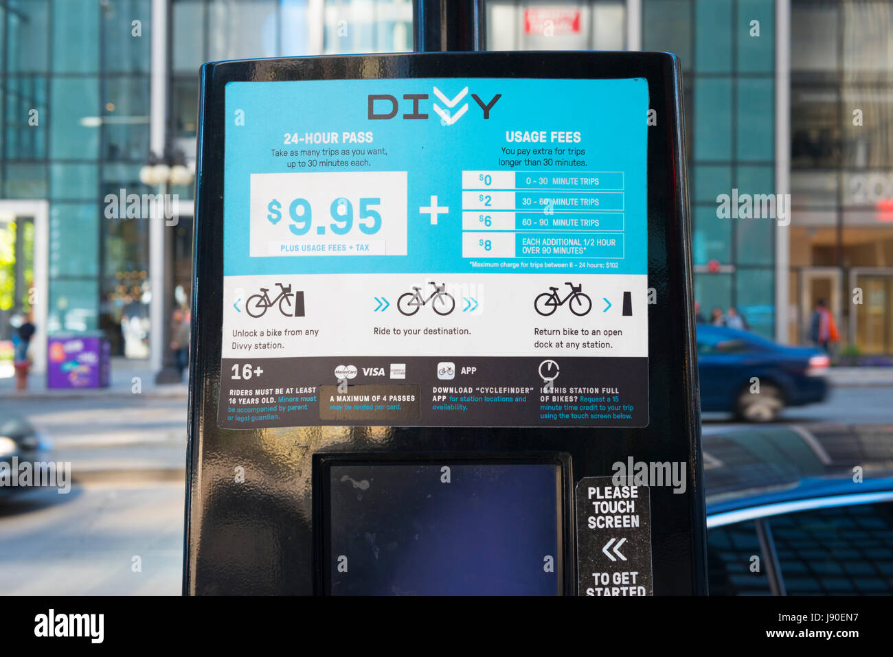 Chicago Illinois Divvy Bike meter bikes hire bicycle bicycles cycle cycles Enjoy the Ride sponsor sponsors licensee - Stock Image