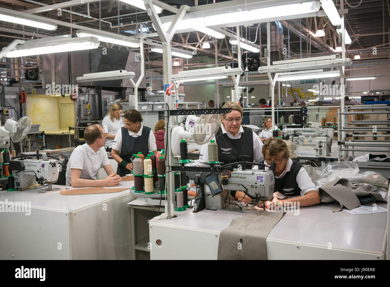 Gaydon, UK - 08/10/2016. Seamstresses in the Aston Martin Factory. Leather seats and detailing is sewn before being - Stock Image