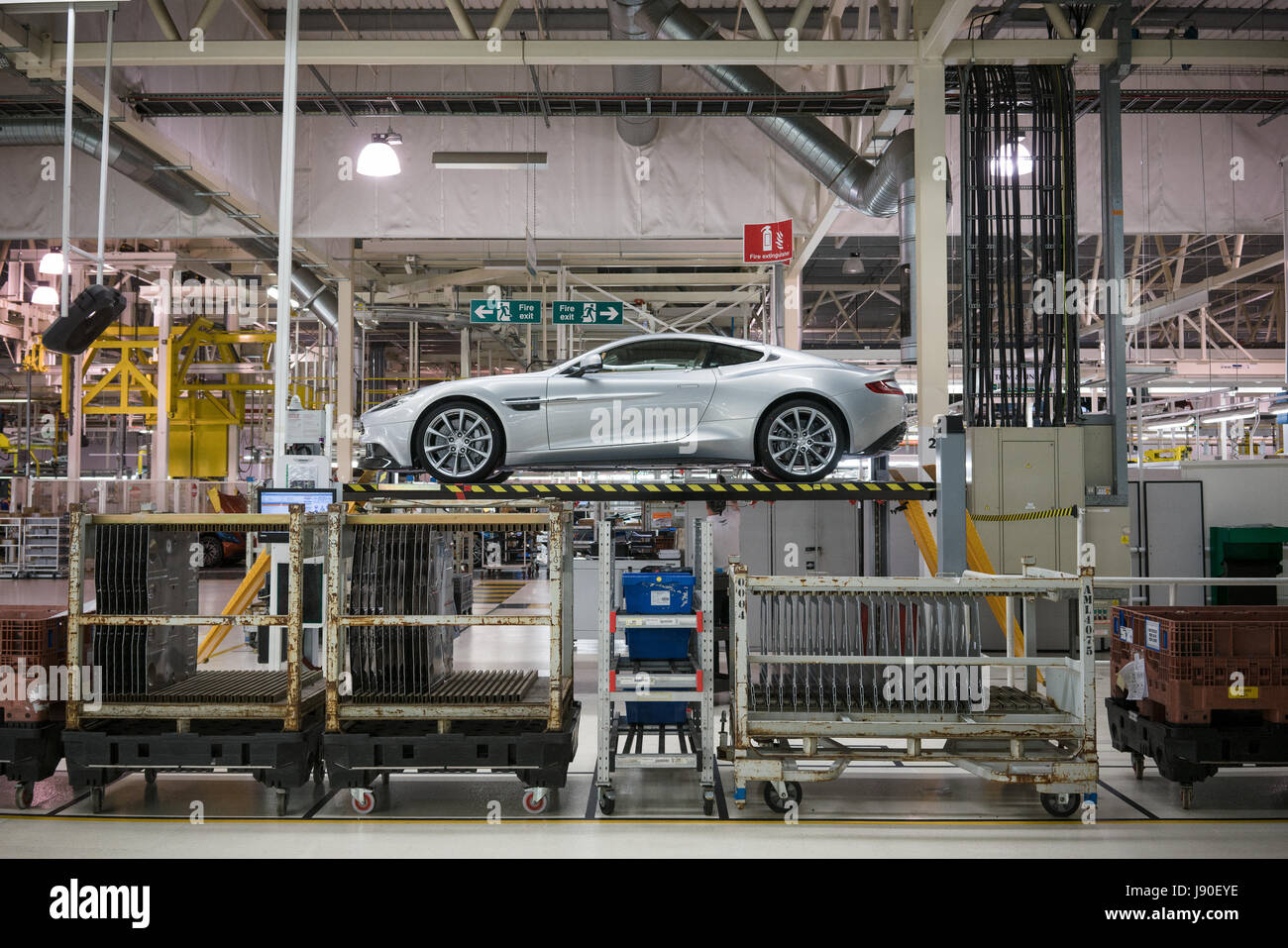 Gaydon, UK - 08/10/2016. An assembled Vanquish is raised up to have checks taken underneath the car. - Stock Image