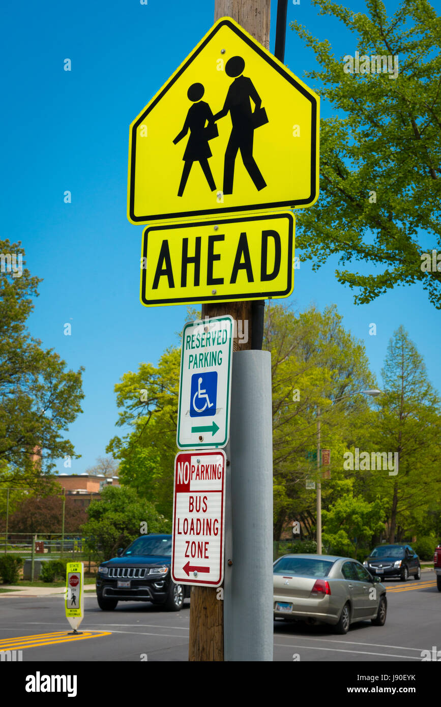 Illinois Oak Park Chicago Avenue street scene road street sign signs Reserved Parking No Parking Bus loading zone - Stock Image