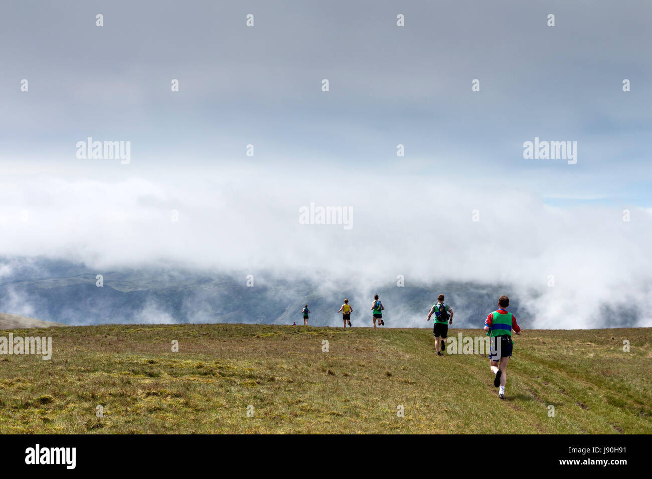 Fell Runners Crossing the Summit of Clough Head During the Helvellyn and the Dodds Fell Race, Lake District, Cumbria, - Stock Image