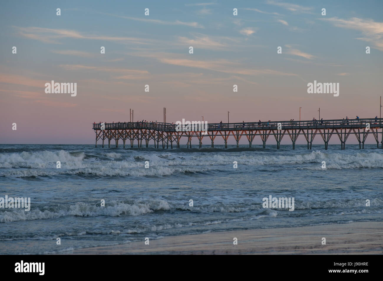 Sunset Beach Fishing Pier at Sunset - Stock Image