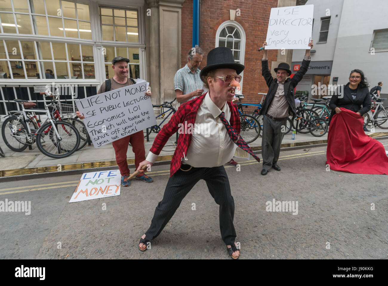 London, UK. 30th May 2017. Life Not Money at the LSE staged street theatre in support of the London School of Economics Stock Photo