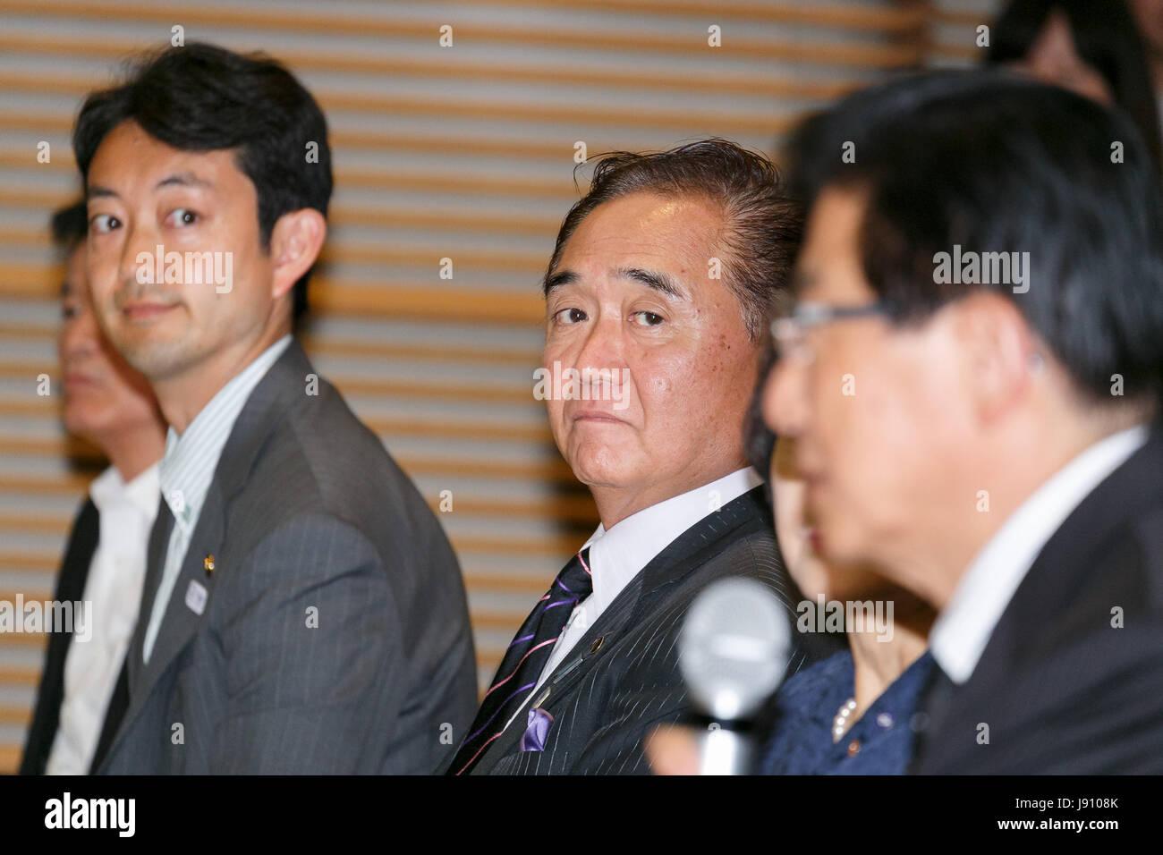 Toshihito Kumagai mayor of the city of Chiba (L) sits alongside Governor of Kanagawa Prefecture Yuji Kuroiwa (C), - Stock Image