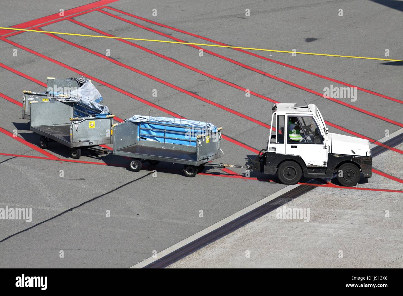 airport apron with baggage carts - Stock Image