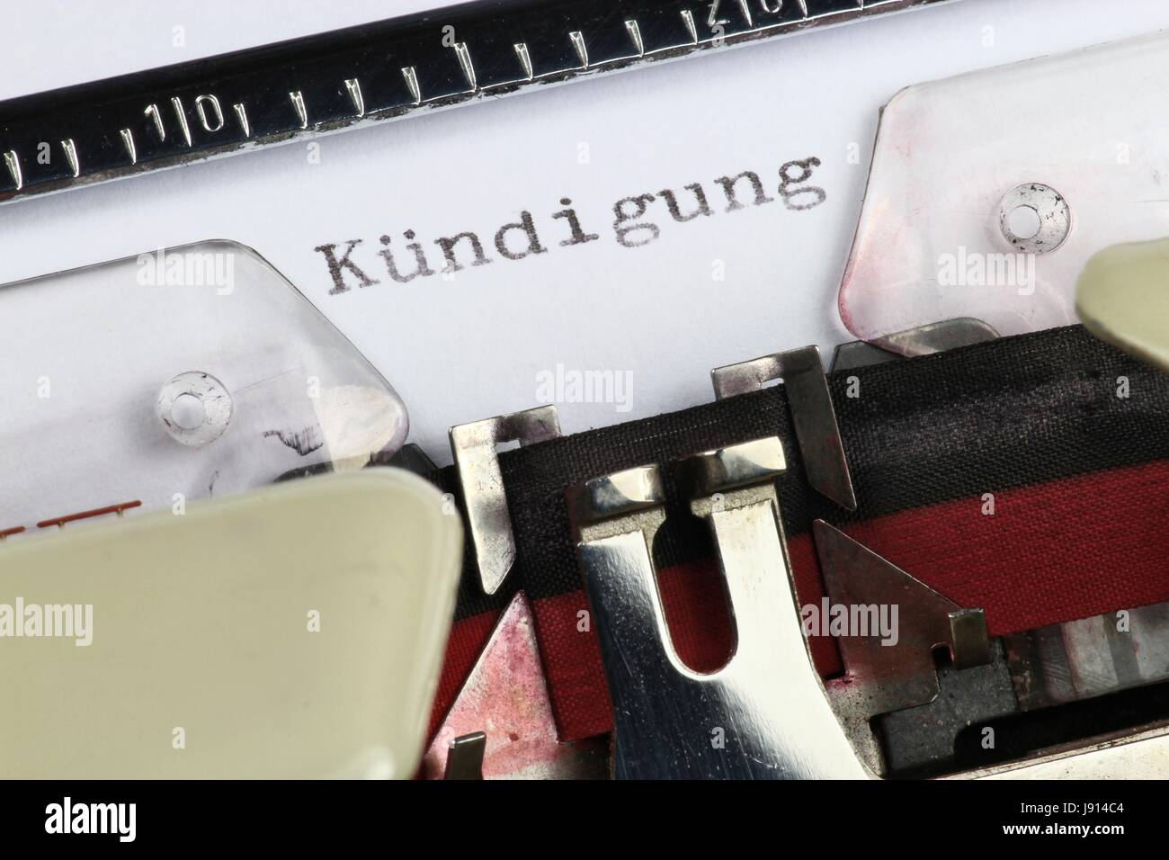 Kündigung (German word for termination) written with old typewriter - Stock Image