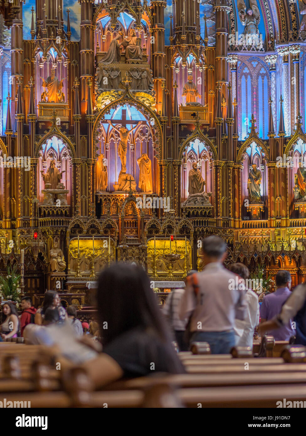The mass and crowd at very popular Notre Dame Basilica, Montreal. Opened for public in 1843, a symbol of Christianity - Stock Image