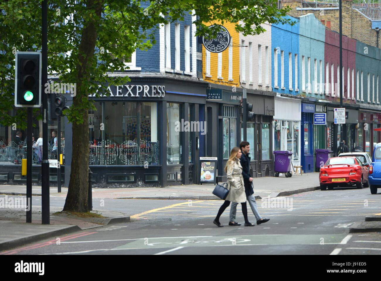 Colourful shops on Kennington Road, Lambeth, London. - Stock Image