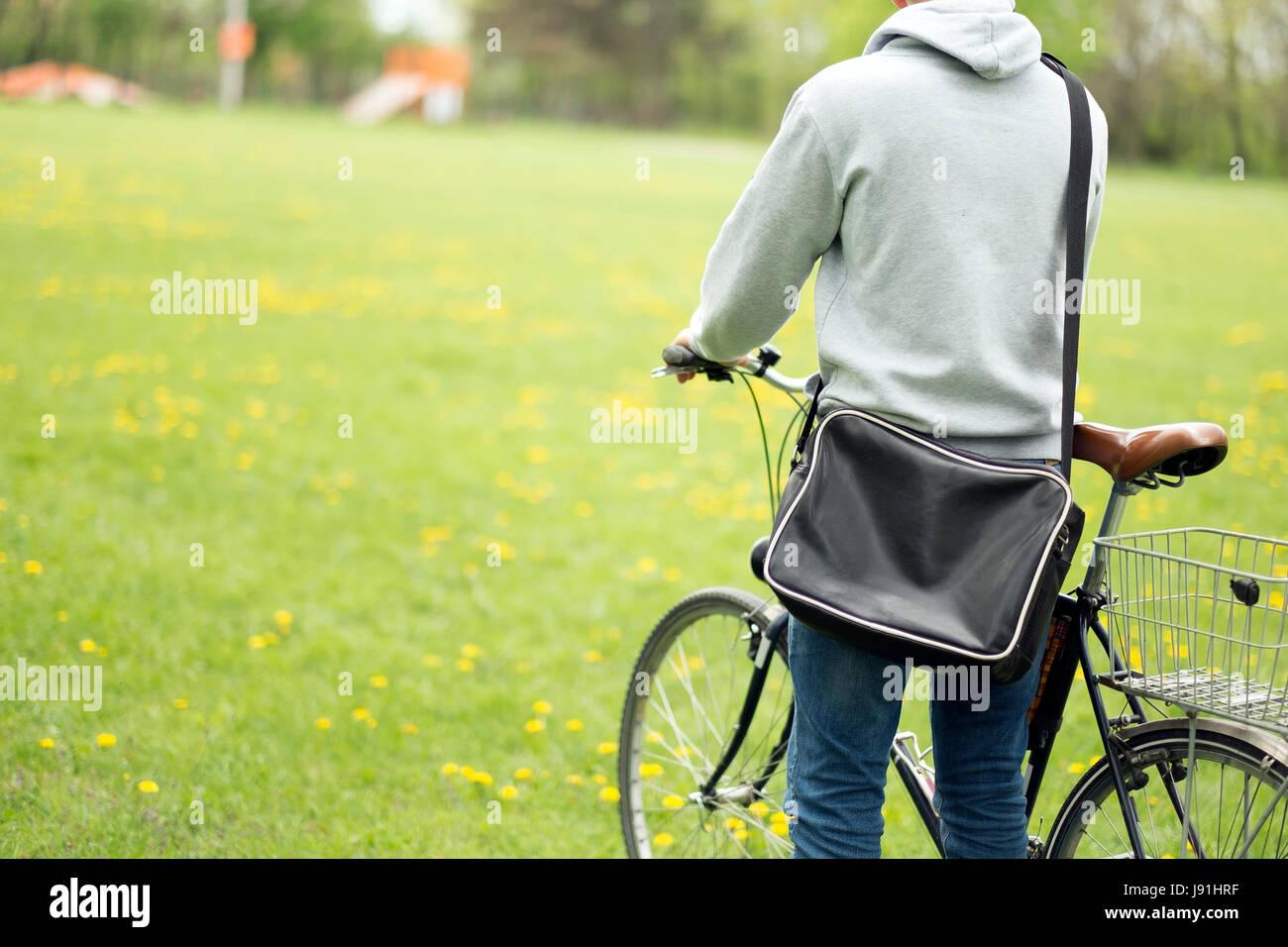 Handsome student man with retro bike - Stock Image