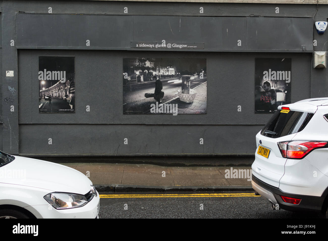 a sideways glance @ Glasgow - photography posters in Glasgow - exhibition by Martin Gray by City Centre Posters - Stock Image