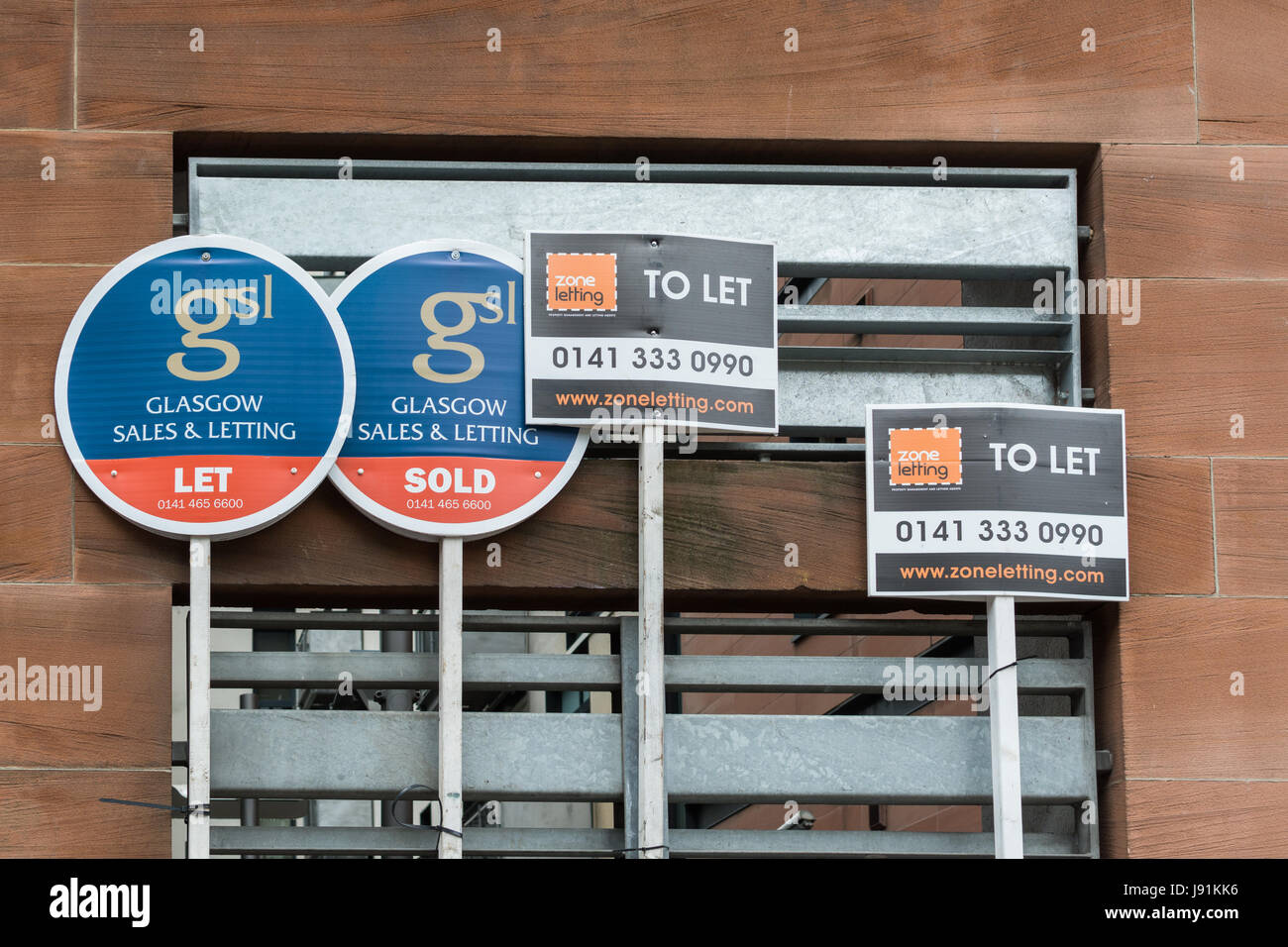 To let and for sale signs in Glasgow city centre, Scotland - Stock Image