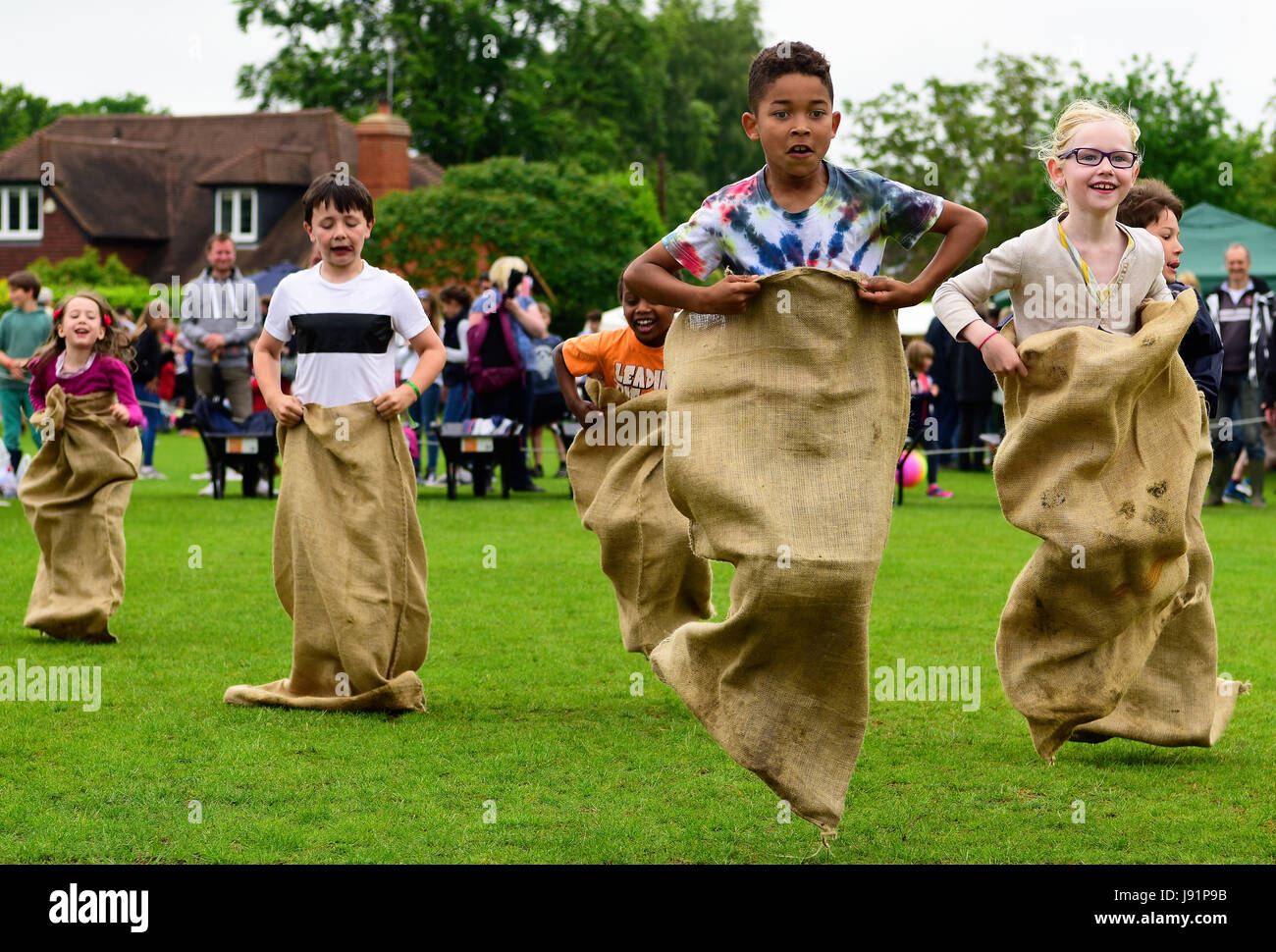 Children's sack race, village fair, Rowledge, UK. 29.05.2017. - Stock Image