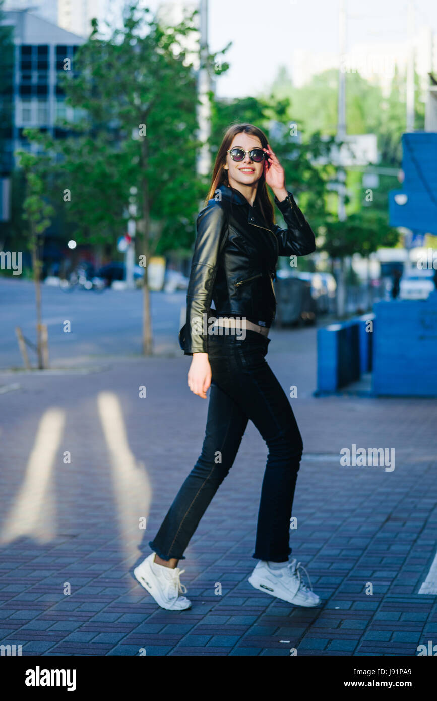 Young beautiful brunette in a city street enjoy her time - Stock Image
