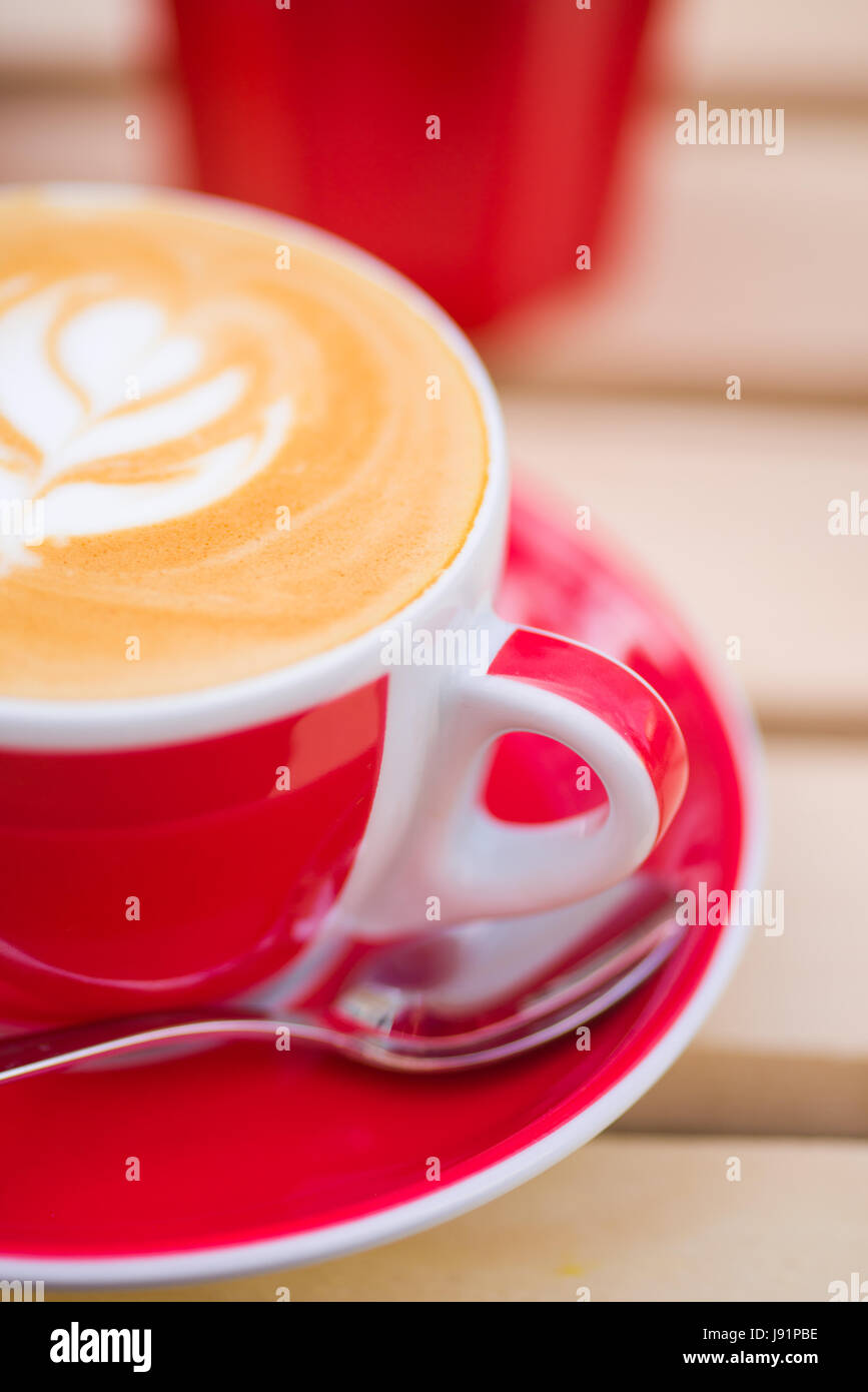 Close-up of cup of Cappuccino coffee with some cool design on the foam - Stock Image