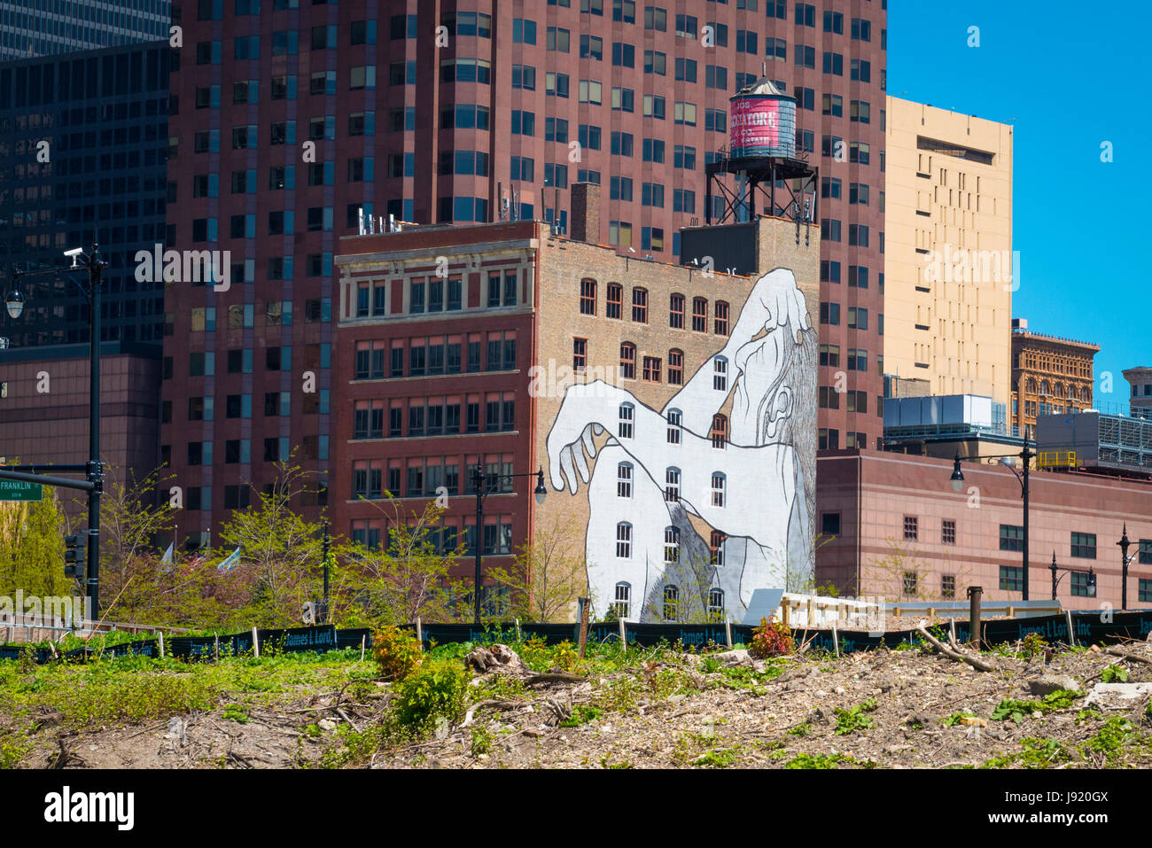 View Chicago River Illinois Downtown riverside buildings old high-rise low-rise large graffiti seated figure water Stock Photo
