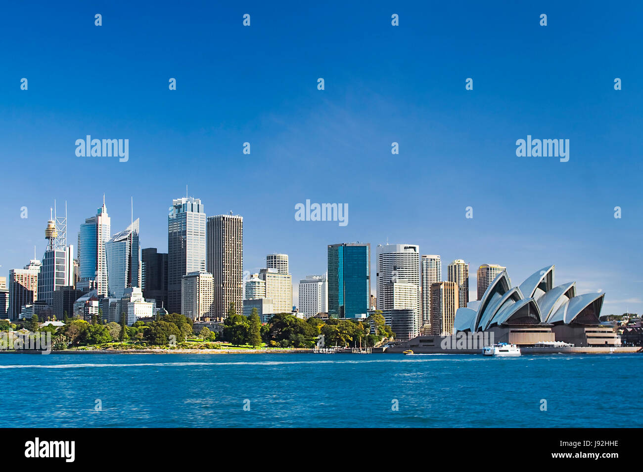 Sydney Australia view from ferry to royal botanic garden, City CBD and downtown houses on a sunny winter day. - Stock Image