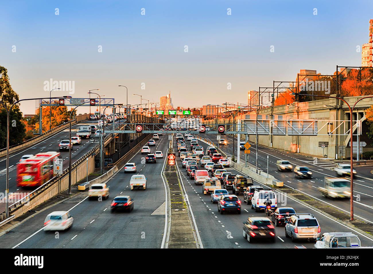 Warringah freeway heavy morning traffic going towards Sydney Harbour Bridge with lots of cars and motor vehicles - Stock Image