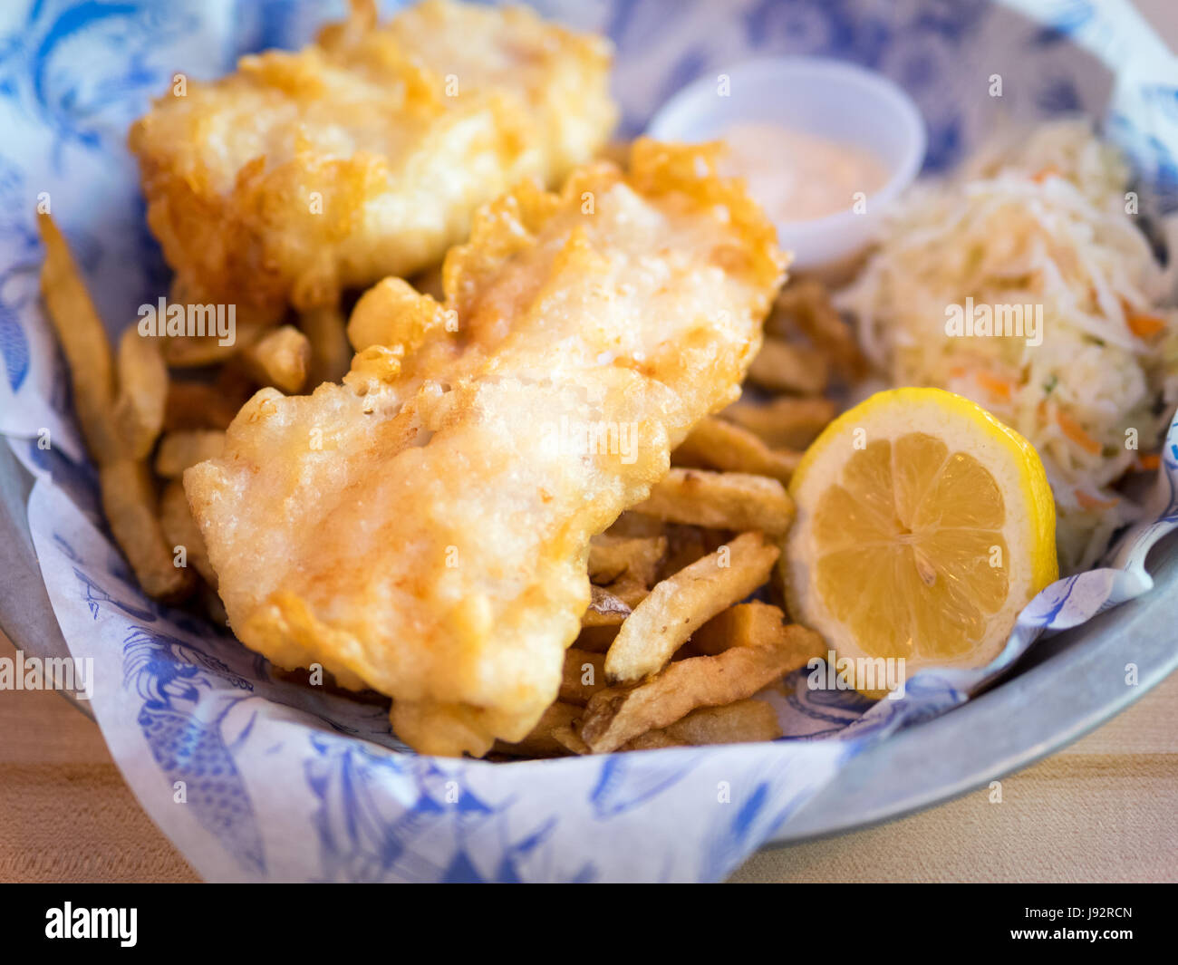 Fish and chips (haddock and chips) from Grandin Fish 'N' Chips, a popular fish and chips shop in Edmonton, - Stock Image